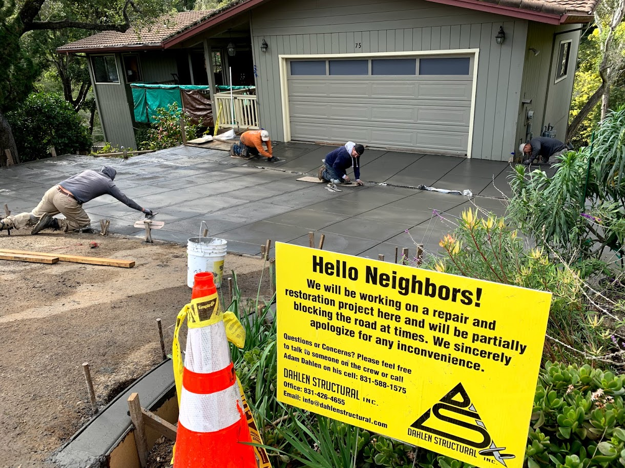 new driveway build with sign